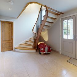 ST088. Curved solid Oak and painted Birch staircase with wrought iron spindles