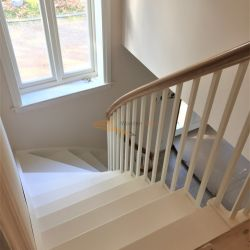 ST094. Curved solid painted Birch hardwood with Oak handrail staircase with Grand Opening