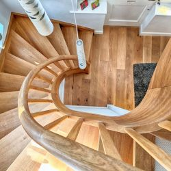 ST096. Two curved solid Oak staircases