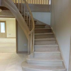 ST101. Curved American White Oak staircase with Grand Opening & curved gallery