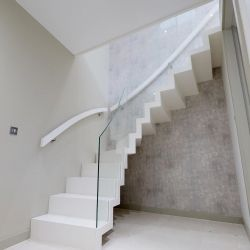 ST102. Floating Zigzag staircase in white painted Birch hardwood with Glass