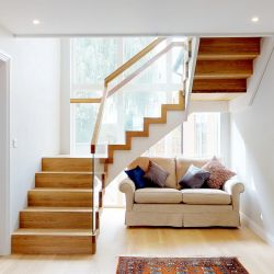 ST106. Contemporary solid Oak and painted Birch staircase with Glass