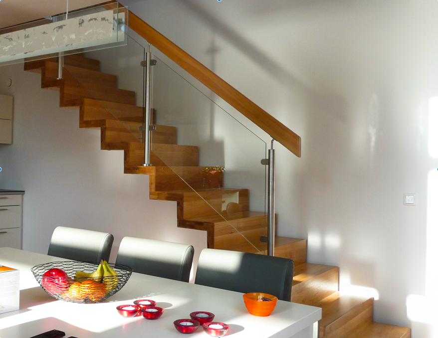 An Oak wooden stair with glass by WoodenStairs in a modern dining room