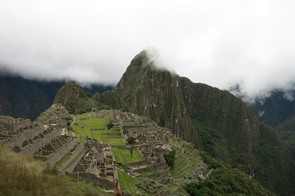 An aerial view of Machu Picchu on a cloudy day