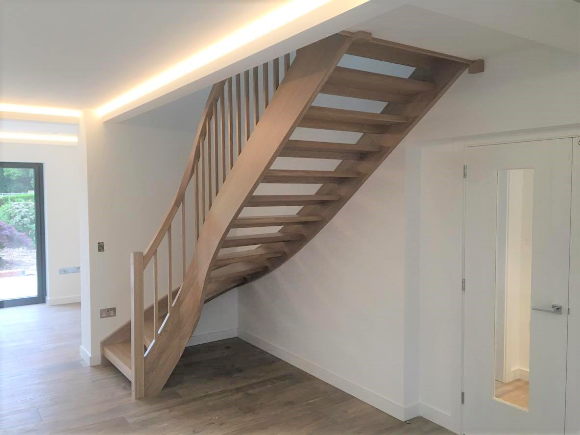 A white oak straight staircase with a twist by WoodenStairs