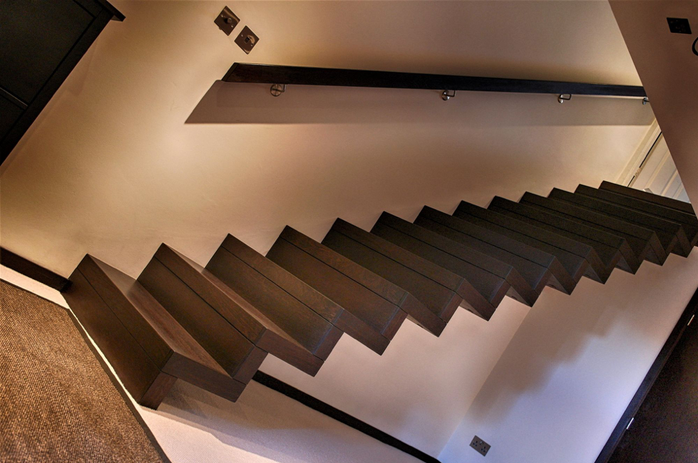 A floating zigzag wooden staircase in solid Wenge by WoodenStairs