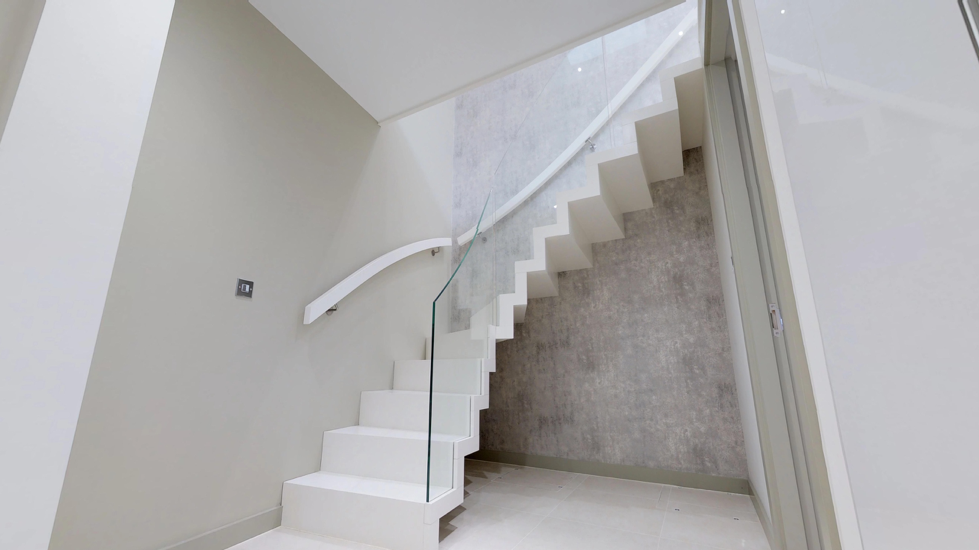 White floating zigzag staircase with glass by WoodenStairs