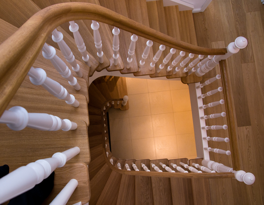 Stained beech stairs with white spindles by WoodenStairs