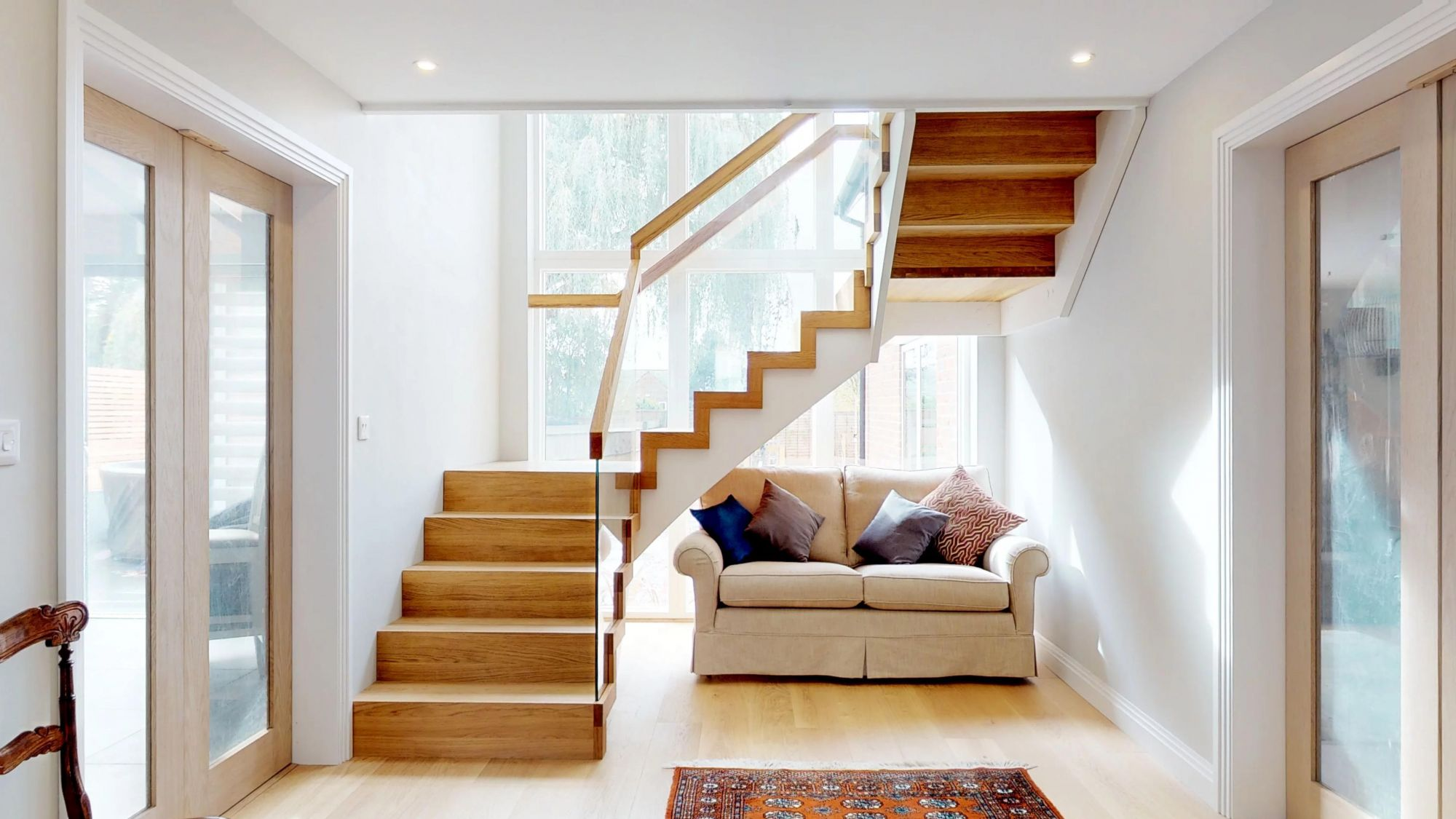 Modern Oak stairs with glass by WoodenStairs