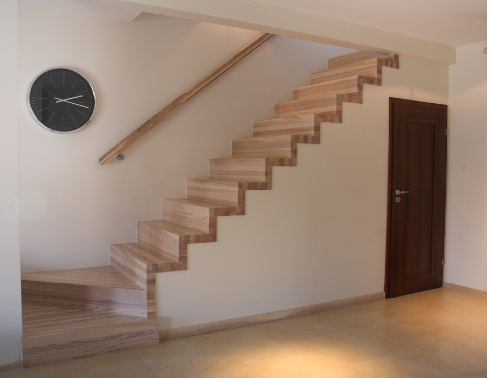 Minimalist wooden stairs with integrated room underneath by WoodenStairs